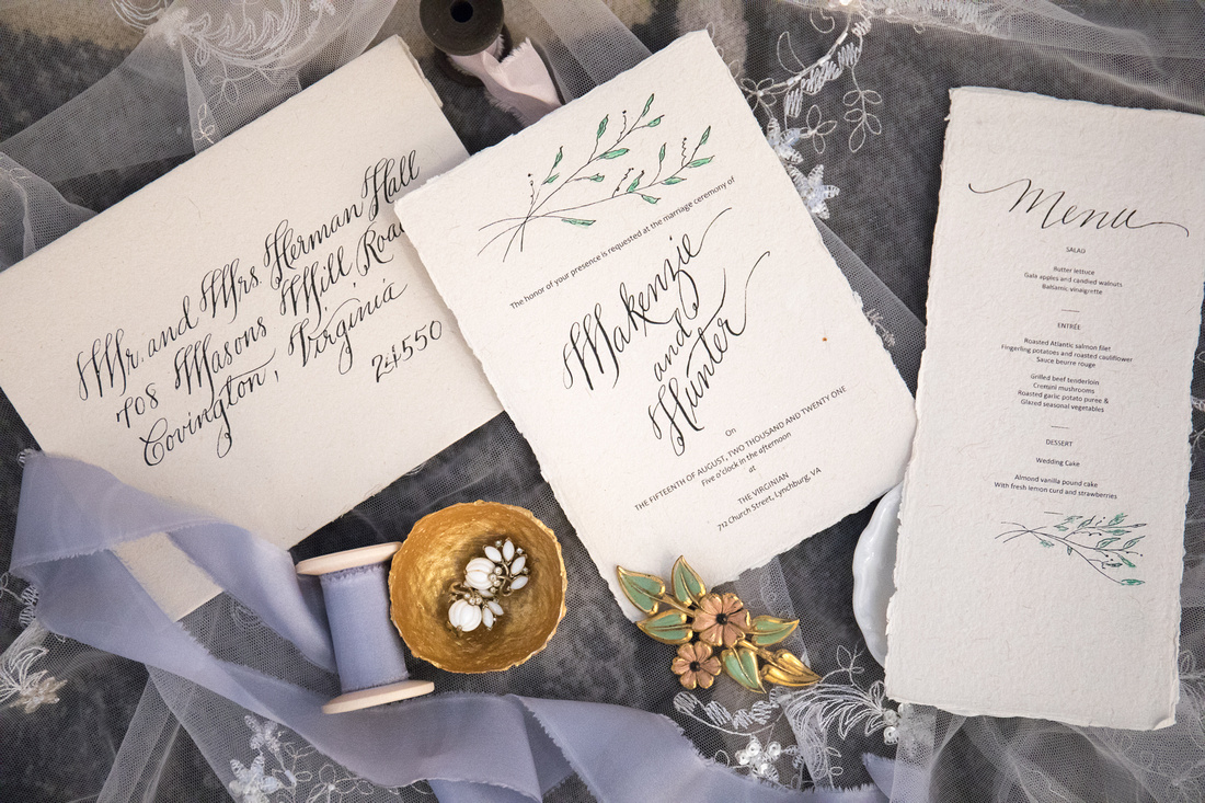 flatlay wedding paper suite details branding for calligrapher and planner
